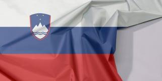 Slowenien-Gewebeflaggenkrepp und -falte mit Leerraum stockfotos