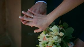Slowly, close up, bride with groom, wedding rings on hands. Ukraine stock video footage