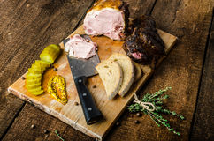 Slowly smoked meat and pickles Royalty Free Stock Photo