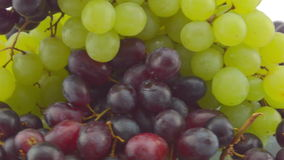 Slowly spinning dizzy clusters of Grapes stock footage