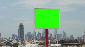 Day Establishing Shot Green Screen Billboard in New York City. A slowly tracking shot of a green screen billboard in Brooklyn with the Manhattan skyline in the stock video footage