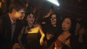 Slowmo group of people halloween costumes pose and dancing at night club party stock footage