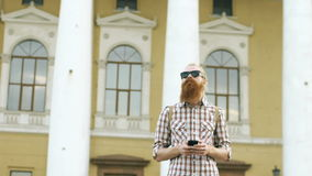 Slowmotion of Bearded tourist man lost in city and using smartphone online map to find right directions stock footage
