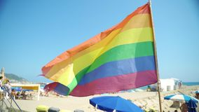 Slow Motion: Gay pride flag blowing in the wind on Sitges Beach, Spain. Slowmotion: Gay pride flag blowing in the wind on Sitges, in Barcelona province. Perhaps stock video