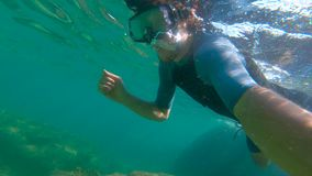 Slowmotion shot of a young man snorkeling in a sea.  stock video