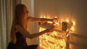 Slowmotion shot of a young woman that makes an advent calendar for her children. Getting ready for Christmas and New stock footage