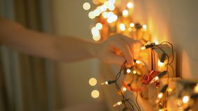 Slowmotion shot of a young woman preparing a Christmas edvent calendar.  stock video footage