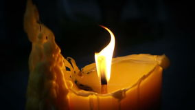 Slowmotion video of a burning candle stock footage