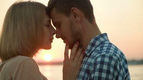 Loving couple hugs at sunset stock video footage
