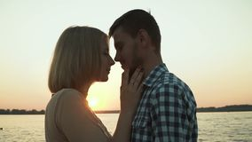 Loving couple at sunset stock footage