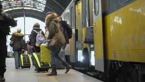 Slowmotion video of people coming out from modern train, traveling, tourism. Stock footage stock video footage