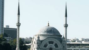 Slowmotion view of famous Istanbul mosque on Bosphorus from floating tourist boat stock footage