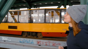 SlowMotion of The Young Woman Running over the Industrial Tram Bridge in City. SlowMotion of The Young Woman Running over the Industrial Urban Tram Bridge in the stock video footage