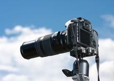 SLR Camera. A digital SLR camera mounted on a tripod Royalty Free Stock Image