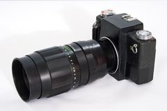 SLR camera with a big lens. Royalty Free Stock Photography