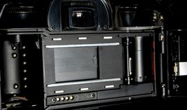 SLR camera body opened back lid to film position Royalty Free Stock Image