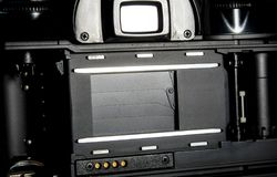 SLR camera body opened back lid to film position Royalty Free Stock Photography