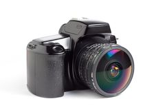 SLR camera and fisheye. A 35mm SLR camera with an 8mm fisheye lens isolated on a white background stock photography