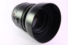 SLR camera lens and hood. Camera lens with hood attached Royalty Free Stock Photography