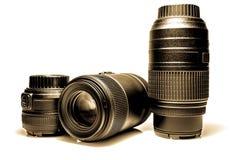 SLR camera lenses close-up. Old retro style vintage photo. SLR camera lenses close-up with reflection. Old retro style vintage photo Royalty Free Stock Photos