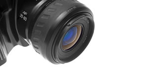 SLR Camera's lens closeup. Closeup of the lens of a black SLR camera. Viewed from the left. Space at the right of the image. Isolated over white background stock photography