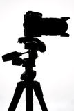 SLR camera on tripod isolated on white Royalty Free Stock Images