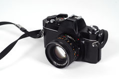 SLR film camera. Black SLR film camera already a vintage, isolated on white Royalty Free Stock Images