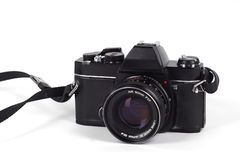 SLR film camera. Black SLR film camera already a vintage, isolated on white Stock Photography