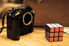SLR film camera with a rubik`s cube royalty free stock images