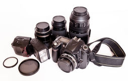 SLR and lenses. Professionally camera SLR,lenses,filters and flash on white background Stock Photos
