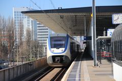 SLT light rail commuter train along platform iat railway station voorburg in the Netherlands. SLT light rail commuter train along platform iat railway station royalty free stock photos