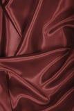 Slätt elegant brunt chokladsilke som bakgrund Arkivfoton