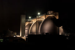 Sludge digestion tanks. Sludge digestion installation on a waste water plant at night. Here is methane produced and used for the energy supply for the plant Royalty Free Stock Photography