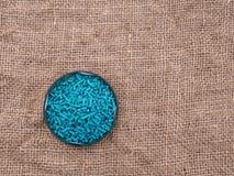 Slug pellets on rustic rumpled hessian Stock Photography