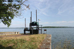 Sluice gate. Old water sluice gate on the shore of a pond Stock Photo