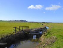 Sluice gate on a drainage ditch Royalty Free Stock Photos