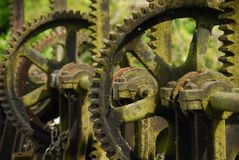 Sluice gate iron cogs stock photos