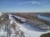 Sluice number 10 on the Moscow river in kolomenskoe district, aerial view, winter drone. A lot of snow and ice royalty free stock image