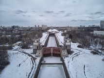 Sluice number 10 on the Moscow river in kolomenskoe district, aerial view, winter drone. A lot of snow and ice stock image