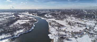Sluice number 10 on the Moscow river in kolomenskoe district, aerial view, winter drone. A lot of snow and ice royalty free stock photography