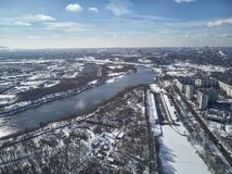 Sluice number 10 on the Moscow river in kolomenskoe district, aerial view, winter drone. A lot of snow and ice royalty free stock photos