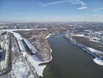 Sluice number 10 on the Moscow river in kolomenskoe district, aerial view, winter drone. A lot of snow and ice royalty free stock photo