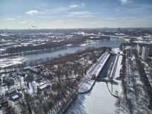 Sluice number 10 on the Moscow river in kolomenskoe district, aerial view, winter drone. A lot of snow and ice stock photography