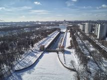 Sluice number 10 on the Moscow river in kolomenskoe district, aerial view, winter drone. A lot of snow and ice stock photos
