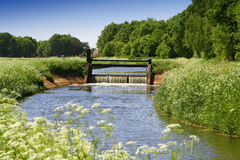 Sluice with stream Stock Images