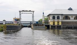 A Sluice on Vltava River And Its Service Building Royalty Free Stock Photos