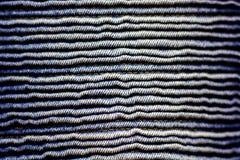 Sluit de omhoog golftextuur van het jeanspatroon Royalty-vrije Stock Afbeeldingen