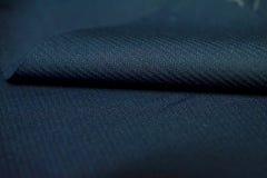 Sluit het patroontextuur van de broodjes omhoog donkerblauwe streep van kostuum Royalty-vrije Stock Foto's