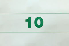 Sluit omhoog aantal op kalenderpagina Stock Foto's