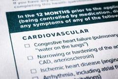 Sluit omhoog cardiovasculaire inhoud op ziektekostenverzekeringvragenlijst royalty-vrije stock foto